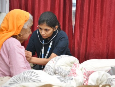 Senior physiotherapist Khushali Shah treating a patient as part of the new 'Home ward' service