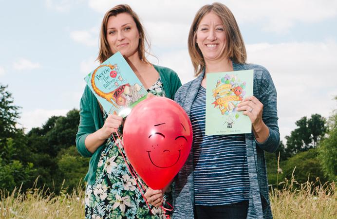 Illustrator Aneta Neuman and author Kim Robinson with Bertie the Balloon and books