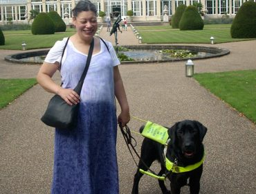 Partially sighted Noula with her guide dog on a trip to Kew Gardens