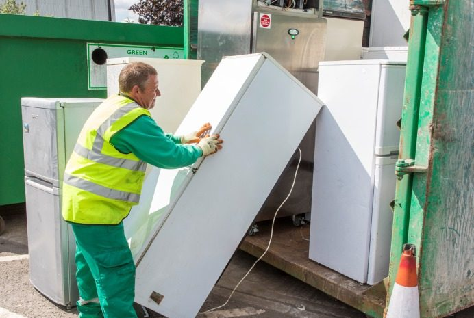 Refrigerators being loaded into a container at Greenford Road Re-use and Recycling centre