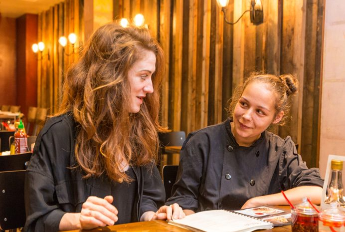 Lucy Taylor and apprentice Katrina Pietersen at Pho restaurant in Ealing