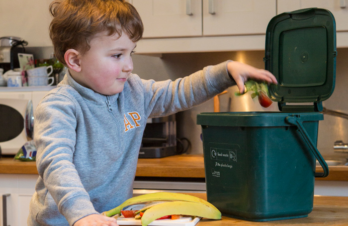 Boy in Ealing recycling food waste