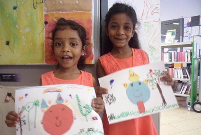 Sisters Kavinela and Kaninela Tharmakulasingam at Northolt Leisure Library