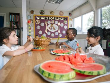 Stanhope Primary School pupils enjoying a healthy snack in the Greenford school's new kitchen