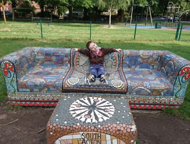 Harley on mosaic bench in South Acton Recreation Ground, by Jayson Hurwood