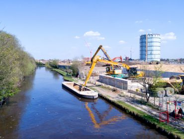 Deliveries by barge on Grand Union Canal, at Southall Waterside development