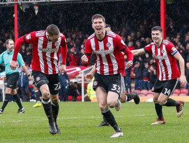 Chris Mepham of Brentford FC celebrates scoring a goal