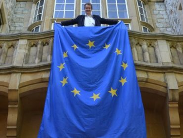Council leader Julian Bell holding an EU flag at Ealing Town Hall