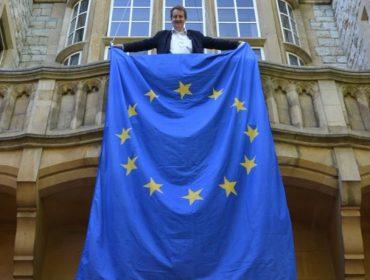 Council leader Julian Bell holding an EU flag at Ealing Town Hall