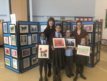 St John Fisher Catholic Primary School exhibition: Shirley Sexton, year 6 teacher and head of English and art; pupils from years 5, 6, 4, and 3; and Christina Urbanski, year 4 teacher and head of humanities.