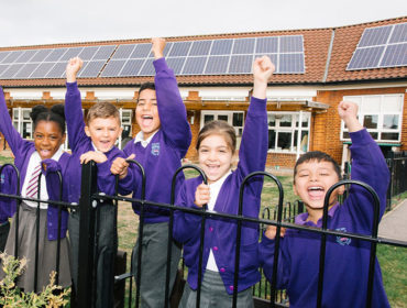 Wood End Primary School council members in front of new solar panels