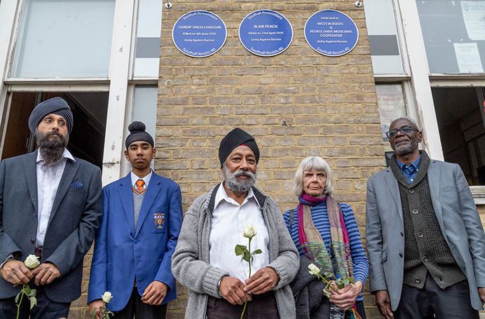 Plaques on Southall Town Hall commemorate Gurdip Singh Chaggar, Blair Peach and Misty in Roots. From right to left: Clarence Baker (original manager of Misty in Roots, and badly injured on 23 April 1979); Celia Stubbs, partner of Blair Peach, who was killed); Karamjit Singh Chaggar, brother of Gurdip Singh Chaggar (who was killed in 1976), Sevak Singh Chaggar, Karamjit's grandson, and Jatinder Singh Chaggar, Karamjit's son. Photo by John Sturrock