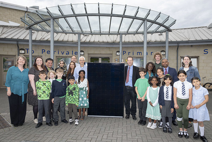 Council leader Julian Bell sees solar panels fitted at Perivale Primary School. Copyright © 2019 Andrew Wiard