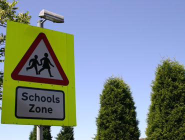 school travel safety sign