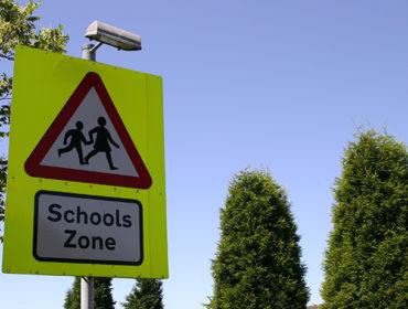 school travel safety sign