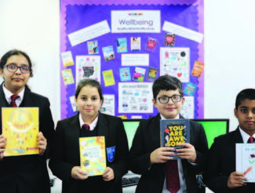 Featherstone High School's wellbeing award: Year 7 pupils enjoying a selection of wellbeing books in the school library