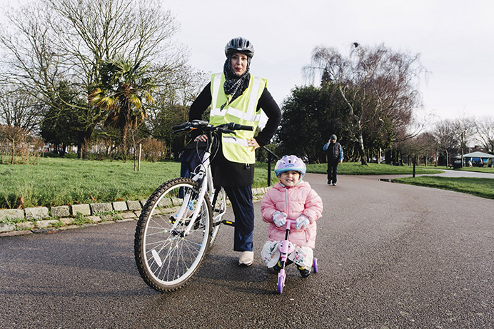Cycling training - Iram Woolley and daughter in Southall Park