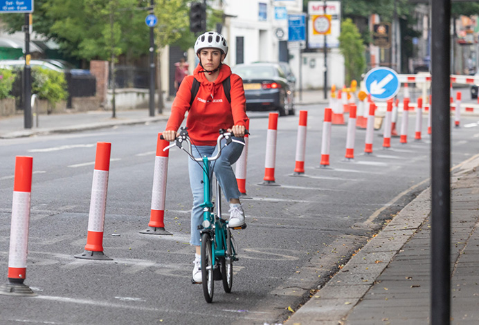 Cyclist using new cycle lane in The Vale, Acton