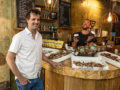 Edwin Harrison, with barista Peter behind the counter at Artisan, Ealing
