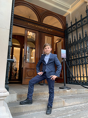 Edward Tabarac of Hanwell on the steps of the Royal Academy of Arts at the opening of its Young Artists Summer Show exhibition, which includes his painting of Pitzhanger Manor