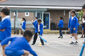 St Anselm's Primary School pupils enjoying cricket - sports participation has increased hugely