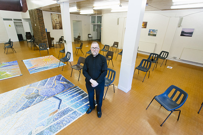 Father Gerard Mitchell of HSSH in the hall at St Anselm's used as a homeless night shelter