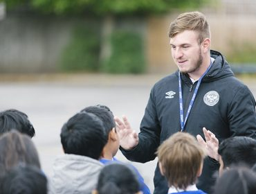 Coach Tommy teaching pupils at St Anselm's Primary School