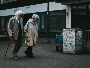 older couple walking on street