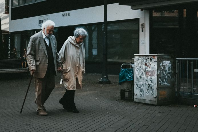 older couple walking on street