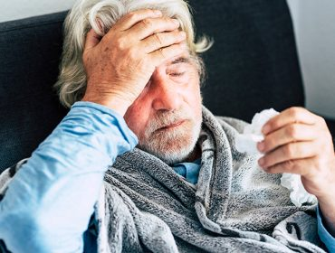 Flu - older man suffering at home with symptoms