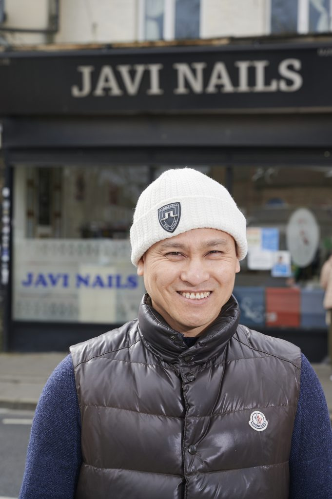 Van Dao owner of Javi Nails outside his business