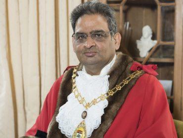 Meet the Mayor of Ealing - Man sits in red robe